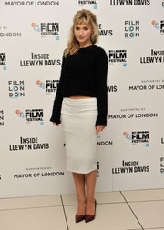 A pair of pointy red pumps finished off Imogen Poots' ensemble in elegant style.