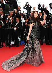 Aishwarya Rai stunned on the red carpet when she wore this gray and black embroidered dress with a flowing train.