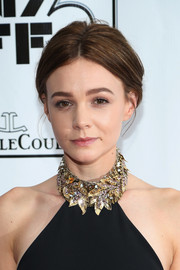 Carey Mulligan opted for a conservative loose updo when she attended the 'Inside Llewyn Davis' premiere.