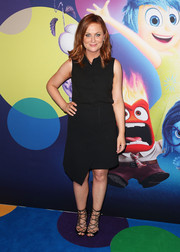 Amy Poehler finished off her look in sexy-chic style with a pair of black lace-up gladiator heels.