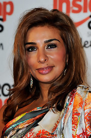 Long false lashes gave Shobna Gulati's eyes a flirty appearance.