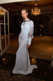 Karolina Kurkova kept it conservative yet sweet in a long-sleeve, flower-appliqued white gown by Honor during the amfAR Inspiration Gala.