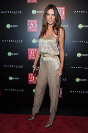 Alessandra Ambrosio looked ready to party in a sparkly gold Houghton jumpsuit during the InStyle 20th anniversary celebration.
