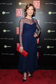 Carrie Coon's red leather clutch provided a striking color contrast to her blue dress.