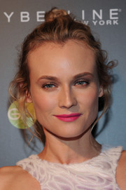 Diane Kruger punctuated her look with a bright pink lip.
