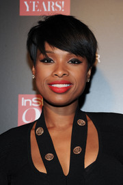 Jennifer Hudson accentuated her pout with a bold red hue.
