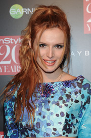 Bella Thorne swept her fiery tresses up into a messy high ponytail for the InStyle 20th anniversary party.