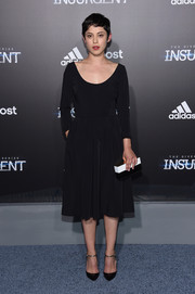 Rosa Salazar styled her dress with a modern-chic black-and-white box clutch.