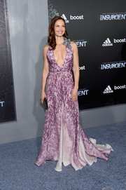 Ashley Judd stole the show in a purple Badgley Mischka print gown with a navel-skimming neckline during the NYC premiere of 'Insurgent.'
