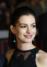 Anne Hathaway complemented her ponytail with a pair of green mirror-ball earrings by Solange Azagury-Partridge.