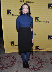Ann Curry looked both cozy and stylish in her long-sleeve dress, tights, and ankle boots.