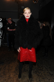Kate Bosworth looked super cozy in a thick black fur coat at the International Woolmark Prize event.