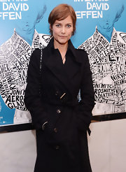 Carey Lowell braved the cold in a buttoned black trenchcoat at the New York premiere of 'Inventing David Geffen.'