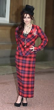 Helena Boham Carter was eclectic as ever in a long plaid skirt suit and top hat.