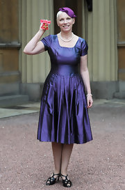 Annie's dainty blue cocktail dress was just perfect for a Buckingham Palace event.