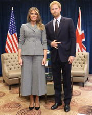 Melania Trump kept it business-like in a houndstooth pantsuit by Dior while meeting with Prince Harry during the Invictus Games.