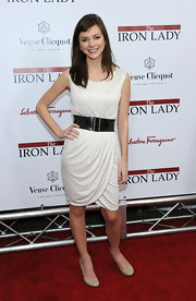 Carrie MacLemore belted a white draped knit dress for the 'Iron Lady' New York premiere.