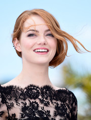 Emma Stone styled her hair into a very loose side chignon for the 'Irrational Man' photocall.