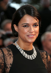 Michelle Rodriguez sported a conservative chignon at the Cannes premiere of 'Irrational Man.'