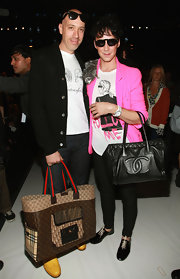Johnny Weir showed off his cool leather tote bag while hitting the Isaac Mizrahi show.