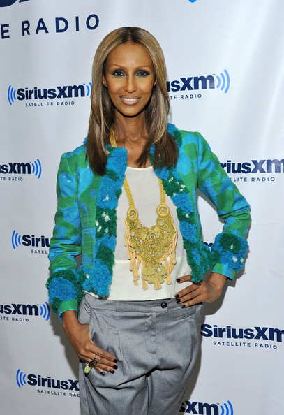 Iman wears a bold gold embroidery necklace with tassels for her visit to Martha Stewart Living Radio.