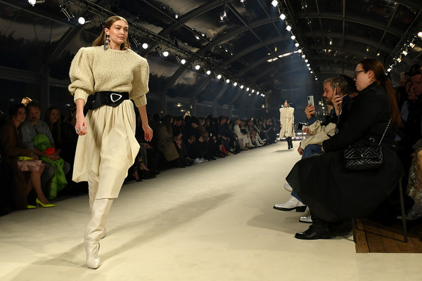 Gigi Hadid wore an oversized beige sweater at the Isabel Marant Fall 2020 show.