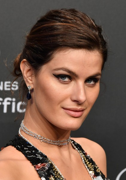 Isabeli Fontana Messy Updo [photo,hair,face,hairstyle,eyebrow,chin,beauty,forehead,eyelash,lip,black hair,isabeli fontana,sidelines,cannes,brazilian,chopard ``space,france,chopard party,party,cannes film festival]