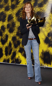 Isabelle Huppert's faded blue bootcut jeans added a bit of an edge to her ensemble at the Festival del Film di Locarno.
