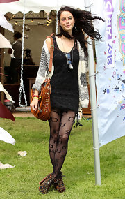 Kaya Scodelario added another layer of texture to her busy ensemble with a pair of lettered tights.