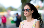 Kaya Scodelario accessorized with a colorful pair of wayfarers during the Isle of Wight Festival.
