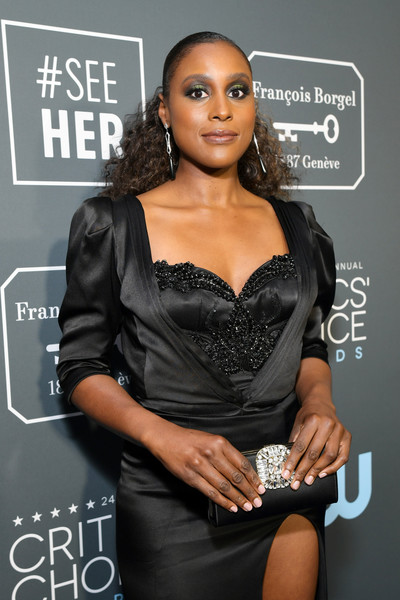 Issa Rae Gemstone Inlaid Clutch [red carpet,clothing,little black dress,hairstyle,dress,lip,cocktail dress,black hair,long hair,eyelash,model,issa rae,critics choice awards,santa monica,california,barker hangar]