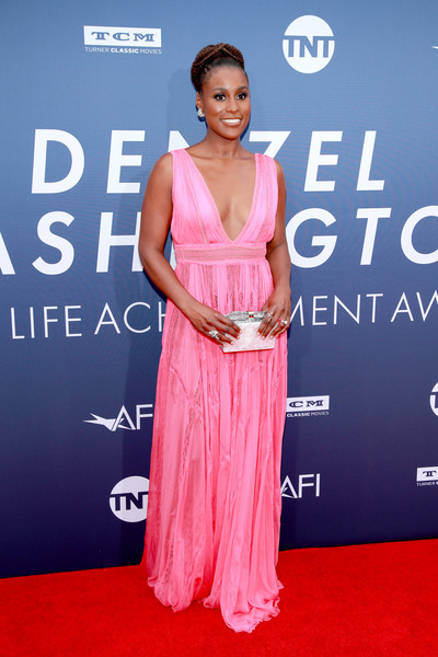 Issa Rae Metallic Clutch [clothing,dress,red carpet,carpet,premiere,shoulder,hairstyle,flooring,fashion,event,arrivals,denzel washington,american film institutes 47th life achievement award gala tribute to,issa rae,afi life achievement award,california,hollywood,dolby theatre]
