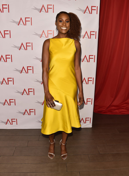Issa Rae Satin Clutch [clothing,dress,yellow,shoulder,fashion model,cocktail dress,fashion,fashion design,footwear,joint,arrivals,issa rae,los angeles,four seasons hotel,california,beverly hills,afi awards]