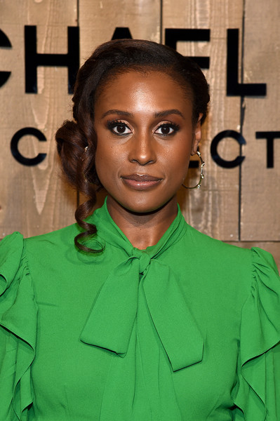 Issa Rae Chignon [hair,face,green,hairstyle,eyebrow,forehead,fashion,black hair,fashion design,long hair,issa rae,front row,new york city,michael kors fw20 runway show,issa rae,new york fashion week,fashion,fashion week,paris fashion week,new york,celebrity,fashion show,clothing,model]