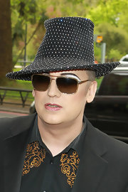 Boy George kept shaded behind these classic brown aviators.