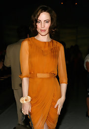 Melissa sat front row at the J. Mendel Spring 2011 Fashion Show wearing a fossilized walrus ivory cuff bracelet.