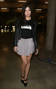 Daisy Lowe's polka dot mini skirt gave her a retro-inspired look while attending the J.W. Anderson runway show.