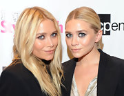 Mary Kate Olsen chose a smoky eye to coordinate with her otherwise subtle makeup at Fashion's Night Out in New York. Recreate her look by lining the inner and outer rims and upper and lower lash lines with plenty of black eye pencil. A heavy dose of a lengthening mascara completes the look.