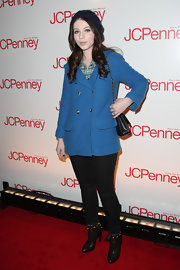 Actress Michelle Trachtenberg came out in a bold blue trench coat, which brought some color to the winter red carpet. She added some edge to her outfit with a pair of studded ankle boots.