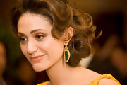 Emmy Rossum added a unique detail to her look with 20-karat gold Luminosity sliced emerald earrings with rose cut diamonds.