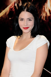 Andrea Duro's crimson lips pop against her porcelain skin. She resembles Snow White with her dark hair and white dress, dontcha think?