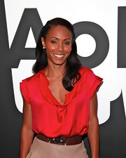 Jada Pinkett styled her hair in a soft half up hairstyle with a sleek side part.