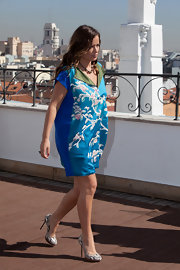 Jade Jagger paired her Orient-inspired dress with snakeskin platform pumps.