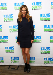 Michelle Monaghan looked effortless in a navy sweater dress with a red neckline at 'Elvis Duran's Z100 Morning Show'.