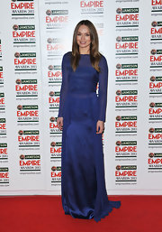 Laura Haddock stunned in a royal blue chiffon and satin dress at the Empire Awards.