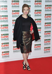 Myanna Buring chose this black knee-length skirt with gold snakeskin panels and zipper embellishments for her look on the red carpet.