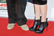 A pair of black ankle booties gave Maia Dunphy a chic and cool red carpet look.