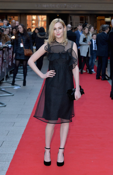 Laura Carmichael complemented her dress with black ankle-strap pumps by Valentino.
