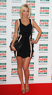 Sarah Harding arrived at the Jameson Empire Film Awards donning a draped black dress. She carried her coveted quilted leather bag while walking the red carpet.