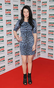 Lynn Collins paired her leopard print dress with black lace peep toe ankle boots.